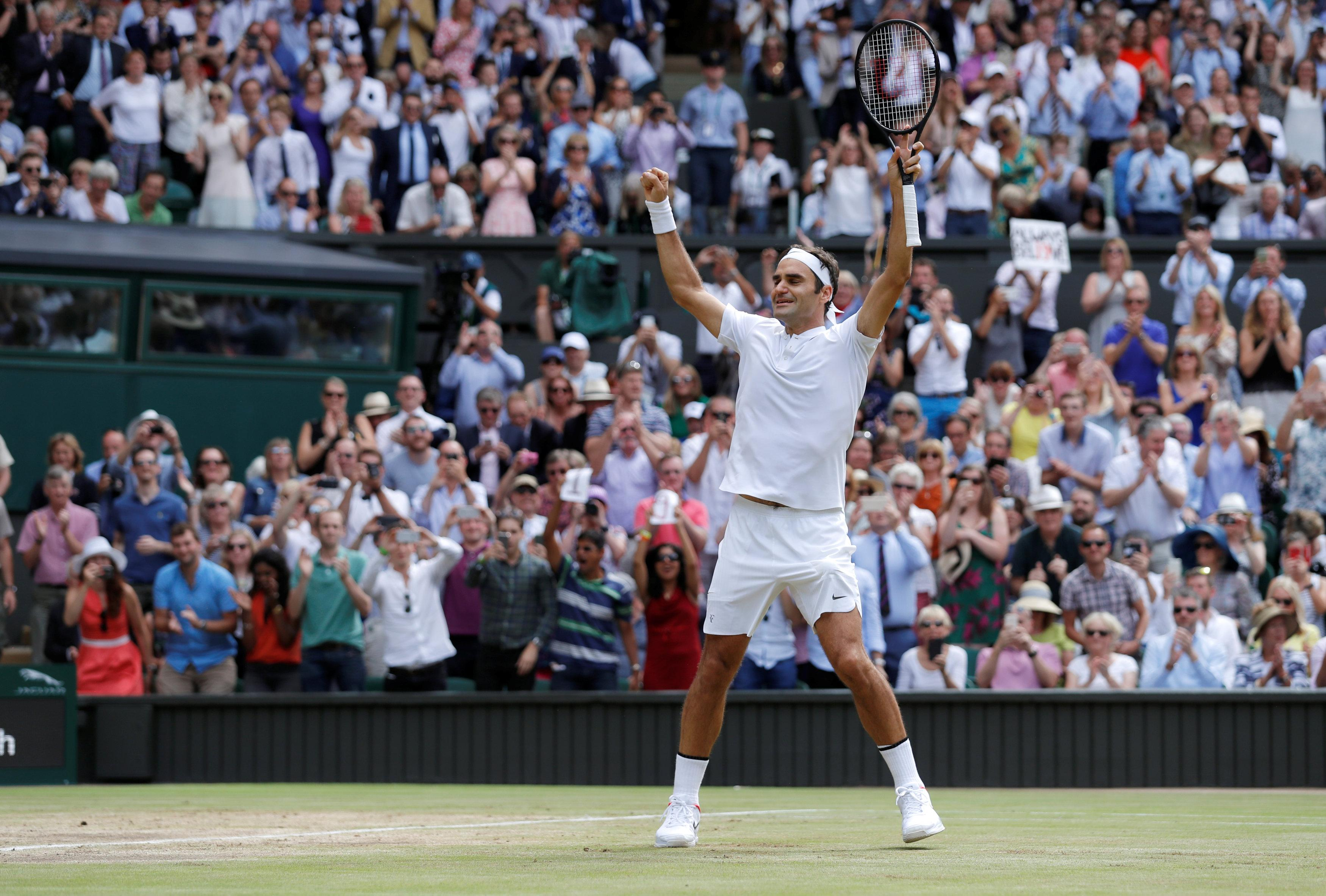 Roger Federer Federer makes Wimbledon history Roger Federer, Tennis
